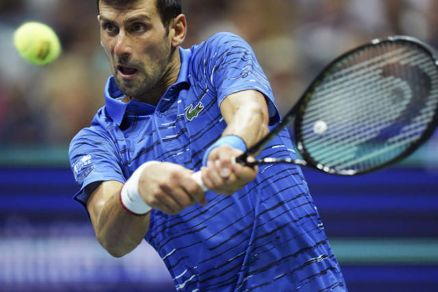 Novak Djokovic, of Serbia, returns to Stan Wawrinka, of Switzerland, during the U.S. Open tennis championships, Sunday, Sept. 1, 2019, in New York. (AP Photo/Eduardo Munoz Alvarez)