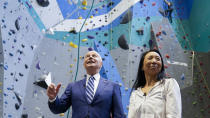 President Joe Biden speaks with president of Sportrock Climbing Centers Lillian Chao-Quinlan as he tours the center Friday, May 28, 2021, in Alexandria, Va. (AP Photo/Evan Vucci)