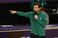 Boston Celtics head Brad Stevens gestures during the first half of an NBA basketball game against the Los Angeles Lakers, Thursday, April 15, 2021, in Los Angeles. (AP Photo/Ringo H.W. Chiu)