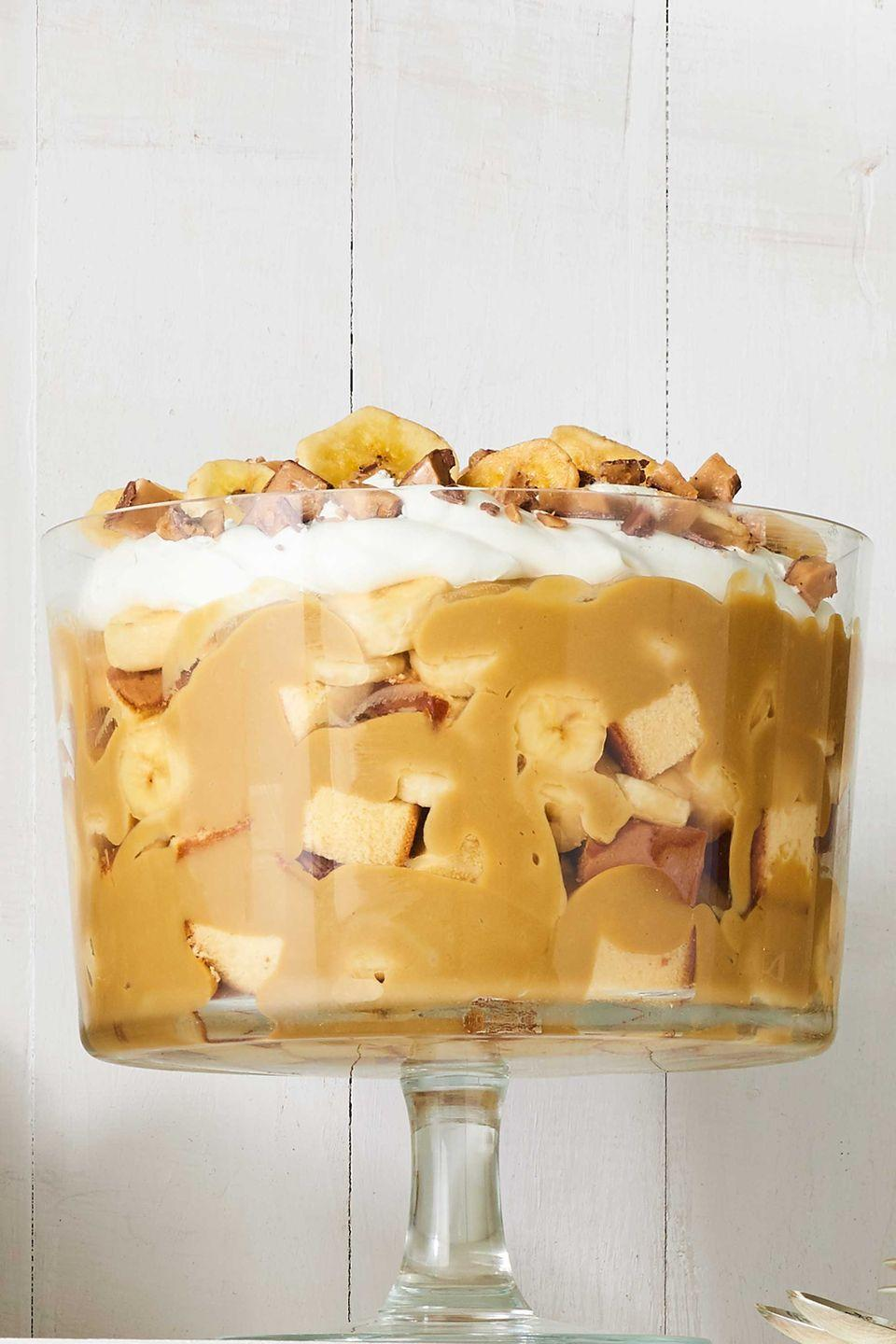 """<p>We can't imagine anything better than a holiday dessert layered with fresh bananas and pound cake. </p><p><strong><a href=""""https://www.countryliving.com/food-drinks/recipes/a40033/butterscotch-banana-trifle-recipe/"""" rel=""""nofollow noopener"""" target=""""_blank"""" data-ylk=""""slk:Get the recipe"""" class=""""link rapid-noclick-resp"""">Get the recipe</a>.</strong></p><p><a class=""""link rapid-noclick-resp"""" href=""""https://www.amazon.com/Anchor-Hocking-Monaco-Trifle-Bowl/dp/B0002YSLXC?tag=syn-yahoo-20&ascsubtag=%5Bartid%7C10050.g.2721%5Bsrc%7Cyahoo-us"""" rel=""""nofollow noopener"""" target=""""_blank"""" data-ylk=""""slk:SHOP TRIFLE BOWLS"""">SHOP TRIFLE BOWLS</a><br></p>"""