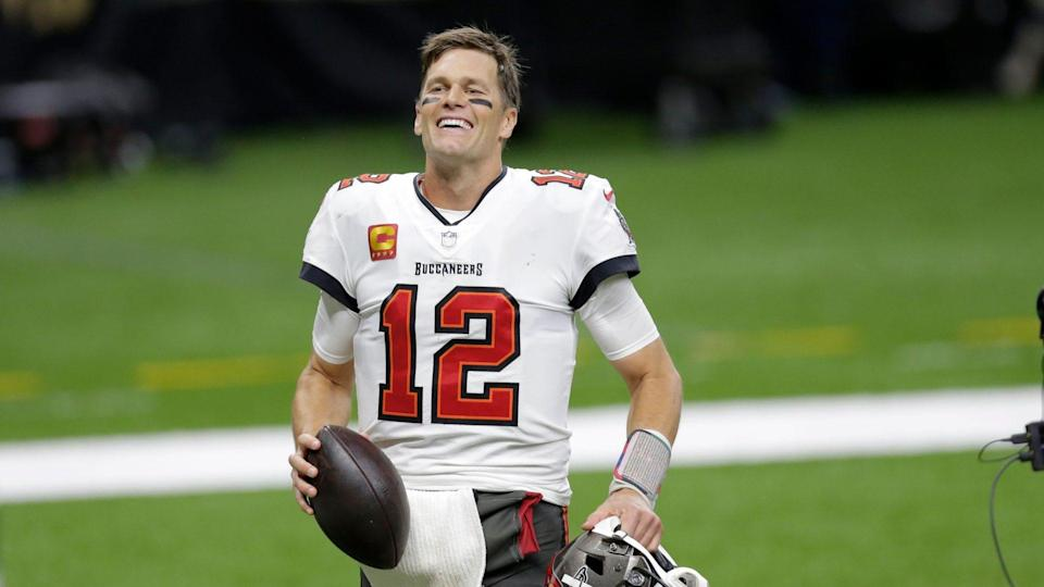 Mandatory Credit: Photo by Brett Duke/AP/Shutterstock (11713998br)Tampa Bay Buccaneers quarterback Tom Brady smiles after an NFL divisional round playoff football game against the New Orleans Saints, in New Orleans.