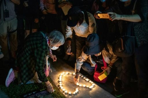 People honor student Alex Chow at rally in Hong Kong's Tamar Park on November 9