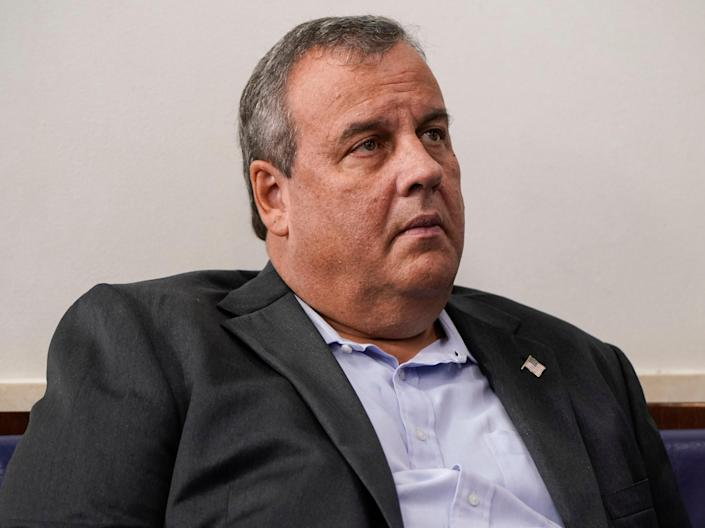 Former New Jersey Governor Chris Christie listens as US President Donald Trump speaks during a news conference in the Briefing Room of the White House on 27 September, 2020 in Washington, DC (Getty Images)