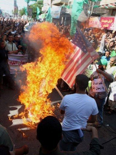 Palestinians burn the US flag in Rafah, during a protest against a film mocking Islam. Anti-US protests by crowds whipped into fury by a film that ridicules Islam's Prophet Mohammed erupted across the Arab world on Friday, leading to an explosion of violence in Sudan, Yemen and Lebanon