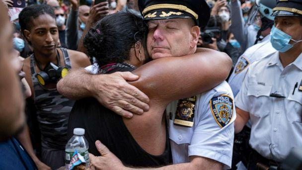 PHOTO: Chief of Department of the New York City Police, Terence Monahan, hugs an activist during a protest in New York, June 1, 2020. (Craig Ruttle/AP)