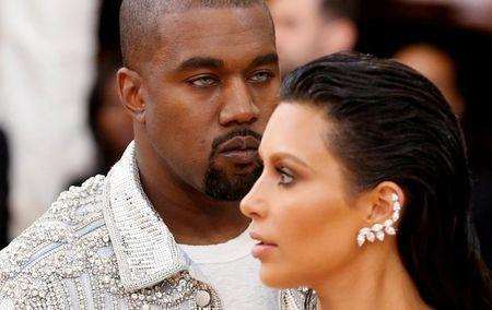 "FILE PHOTO -  Musician Kanye West (L) and wife Kim Kardashian arrive at the Metropolitan Museum of Art Costume Institute Gala (Met Gala) to celebrate the opening of ""Manus x Machina: Fashion in an Age of Technology"" in the Manhattan borough of New York, May 2, 2016.  REUTERS/Lucas Jackson/File Photo"