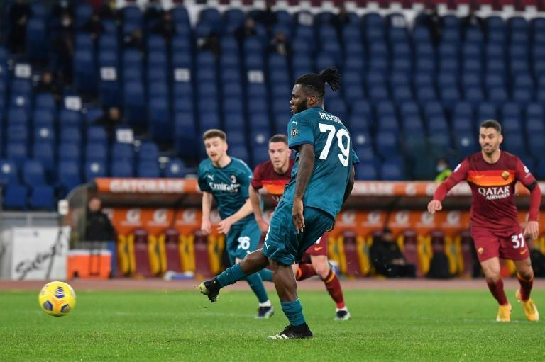 Midfielder Franck Kessie (L) puts AC Milan ahead against Roma by converting a penalty at the weekend