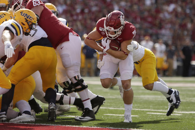 Washington State running back Max Borghi, second from the right, runs for a touchdown while defended by Northern Colorado defensive back Aaron Harris during the first half of an NCAA college football game in Pullman, Wash., Saturday, Sept. 7, 2019. (AP Photo/Young Kwak)
