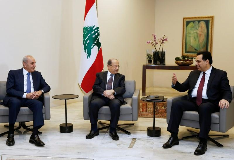 Designated Prime Minister Hassan Diab meets with Lebanon's President Michel Aoun and Lebanese Speaker of the Parliament Nabih Berri at the presidential palace in Baabda