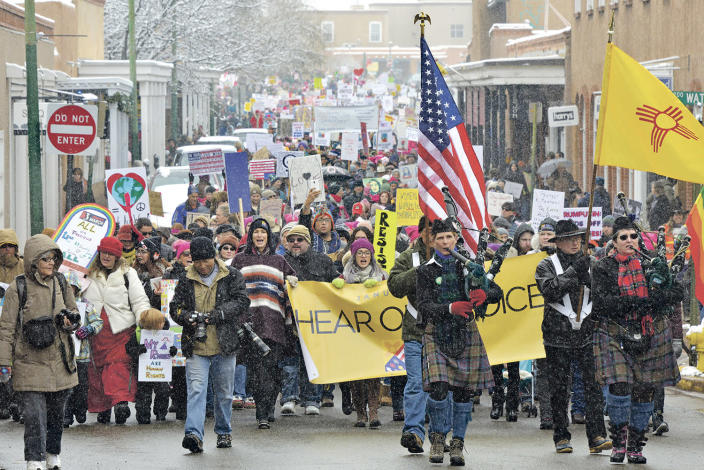 <p>Thousands march north on Galisteo St in a sister march in Santa Fe, New Mexico to the D.C. Women's March on Washington. The march went from the Bataan Memorial Building, around the Santa Fe Plaza and then to the New Mexico State Capitol for a noon to 2 p.m. rally Saturday, Jan. 21, 2017. (Clyde Mueller/Santa Fe New Mexican via AP) </p>