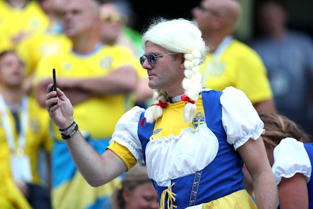 <p>Swedish blonde: This Scandinavian supporter got into the full fancy dress spirit. (Getty) </p>