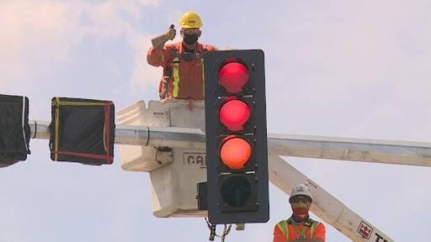 The new lights at the main intersection in Bragg Creek will be operational by the Victoria Day weekend. (Helen Pike/CBC - image credit)