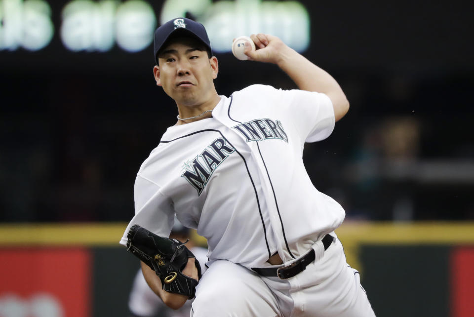 Seattle Mariners starting pitcher Yusei Kikuchi throws against the Kansas City Royals in the first inning of a baseball game Tuesday, June 18, 2019, in Seattle. (AP Photo/Elaine Thompson)