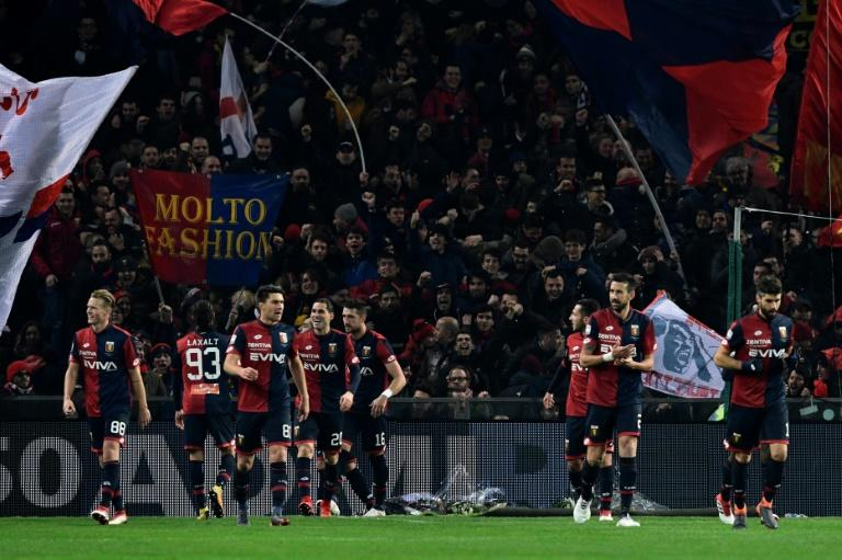 Time to celebrate: Genoa's players after beating Inter Milan