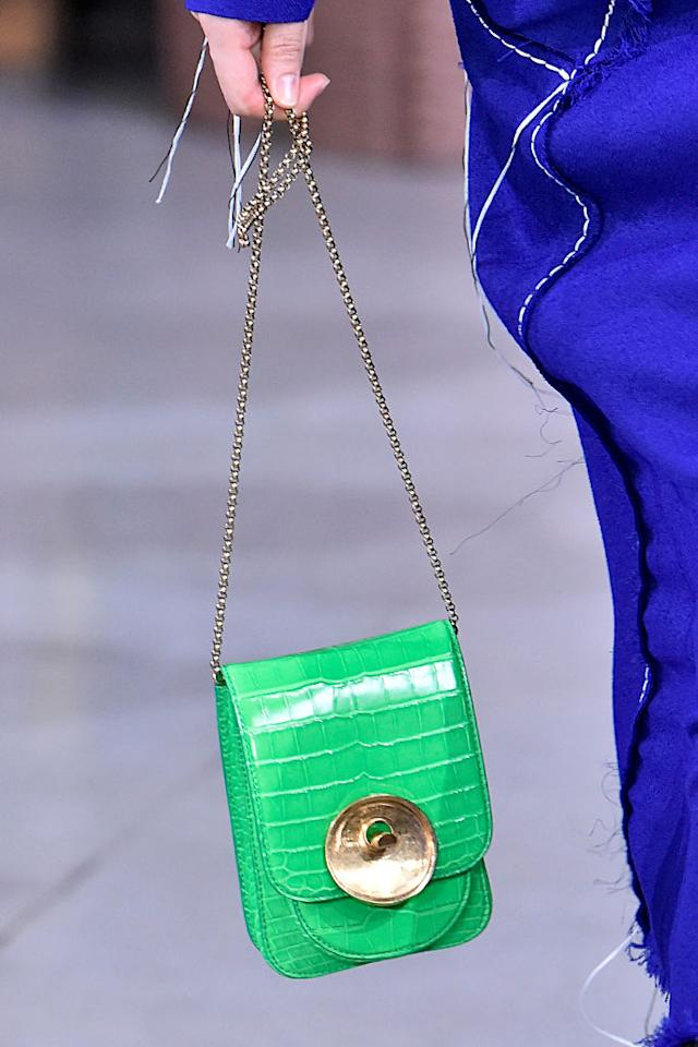 <p>A model carries a mini-chain bag from the Marni FW18 show. (Photo: Getty Images) </p>