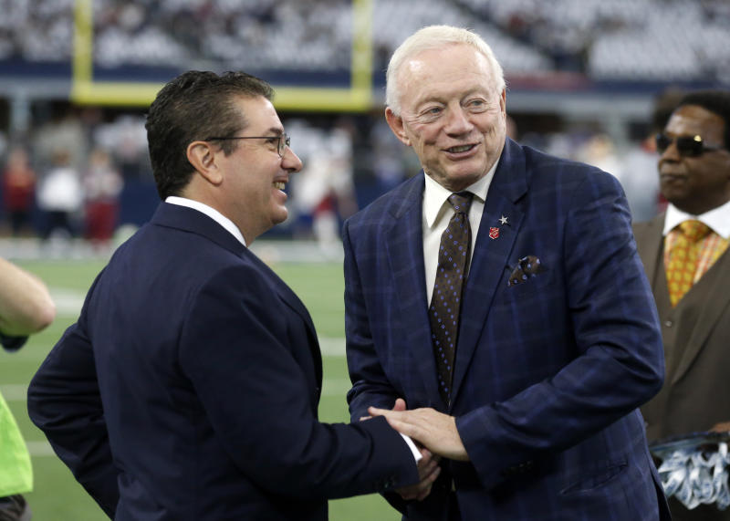 Washington Redskins owner Daniel Snyder, left, and Dallas Cowboys owner Jerry Jones, right, greet each other before a game on Nov. 24, 2016, in Arlington, Texas. (AP Photo/Michael Ainsworth)