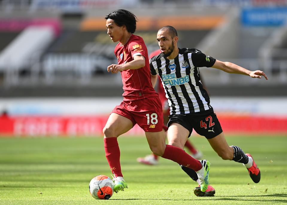 Newcastle United's Nabil Bentaleb (right) in action with Liverpool's Takumi Minamino.