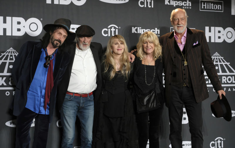 Stevie Nicks, center, posing with other members of Fleetwood Mac, from left, Mike Campbell, John McVie, Christine McVie and Mick Fleetwood at the Rock & Roll Hall of Fame induction ceremony in New York. (Photo by Charles Sykes/Invision/AP, File)