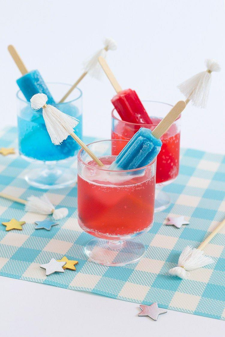 """<p>Stock up on popsicles and bubbly so you can enjoy this effortless, celebratory drink at a moment's notice.<em><br></em></p><p><a href=""""http://www.freutcake.com/in-the-kitchen/drinks-anyone/popsicle-cocktails-tassel-stir-sticks/"""" rel=""""nofollow noopener"""" target=""""_blank"""" data-ylk=""""slk:Get the recipe from Freutcake »"""" class=""""link rapid-noclick-resp""""><em>Get the recipe from Freutcake »</em></a></p>"""