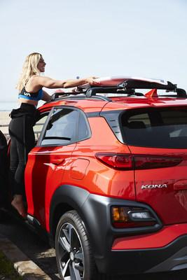 WSL professional surfer Sage Erikson loads her surfboard on top of a 2020 Hyundai Kona with a Thule rack