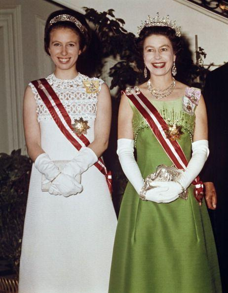 <p>In May 1969, the monarch and her daughter, Princess Anne, went on a state visit to Austria. Both royals went full glamorous for an event at the British Embassy: Anne wore a white dress with a sash, gloves, and a tiara, while the Queen wore a lime green gown with a matching sash and <em>lots</em> of jewelry. </p>