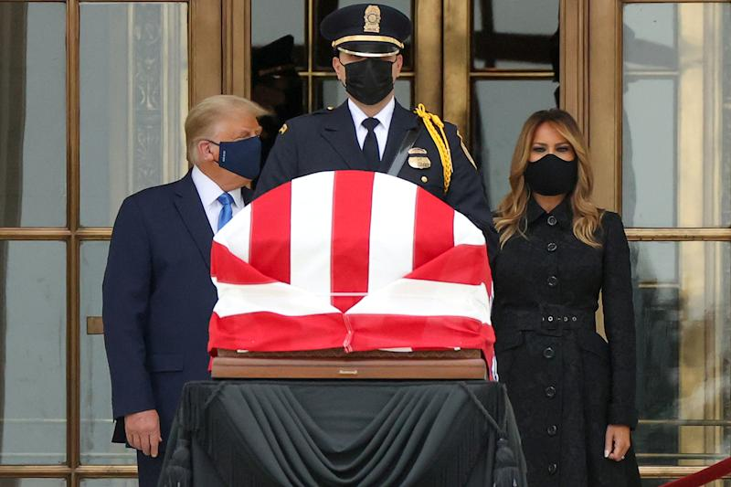 US President Donald Trump and First Lady Melania Trump stand next to Justice Ruth Bader Ginsburg's casket.