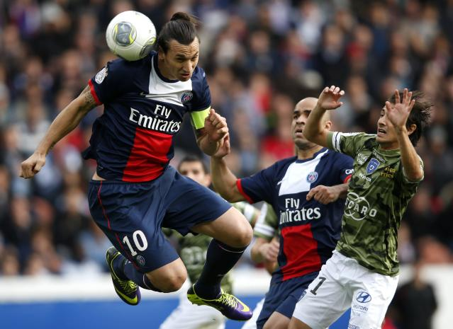 Paris St Germain's Zlatan Ibrahimovic challenges Bastia's Fethi Harek (R) and scores his second goal during their French Ligue 1 soccer match at the Parc des Princes Stadium in Paris October 19, 2013. REUTERS/Benoit Tessier (FRANCE - Tags: SPORT SOCCER)