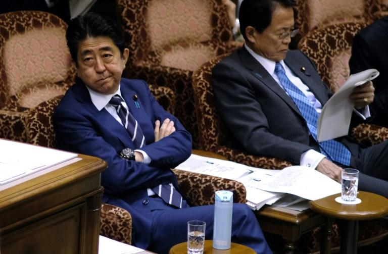 Prime Minister Shinzo Abe and Finance Minister Taro Aso are under pressure over the scandal