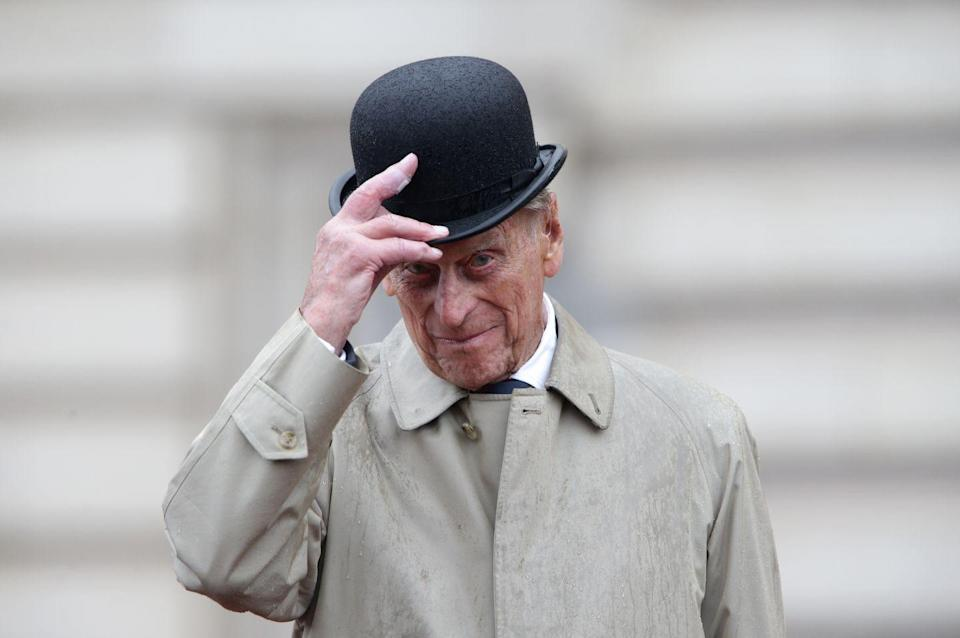 """<p>Prince Philip raises his hat in his role as Captain General of the Royal Marines. Here, he made his <a href=""""https://www.goodhousekeeping.com/uk/news/a570337/prince-philips-final-public-engagement-august-marines/"""" rel=""""nofollow noopener"""" target=""""_blank"""" data-ylk=""""slk:final individual public engagement"""" class=""""link rapid-noclick-resp"""">final individual public engagement</a> at a parade to mark the finale of the 1664 Global Challenge, on the Buckingham Palace Forecourt in 2017.</p>"""