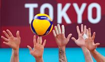 <p>A men's volleyball semi-final match between Brazil and the ROC Team during the Tokyo 2020 Summer Olympic Games, at the Ariake Arena. Stanislav Krasilnikov/TASS (Photo by Stanislav Krasilnikov\TASS via Getty Images)</p>