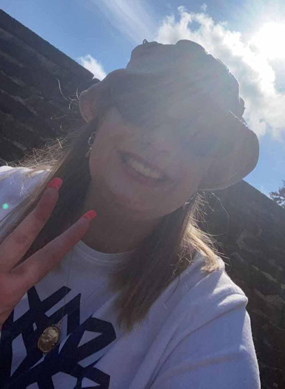 Lauren a week after being in hospital, wearing a hat to protect her from the sun. PA REAL LIFE