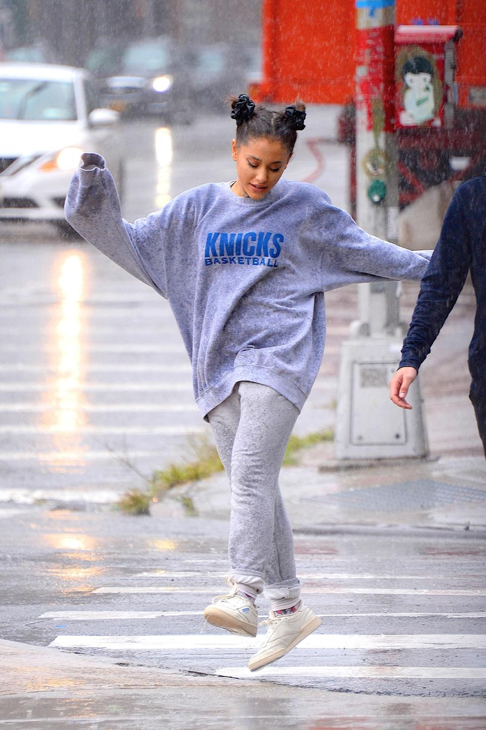 Grande dancing in the rain with space buns and a grey sweatsuit is a forever mood.
