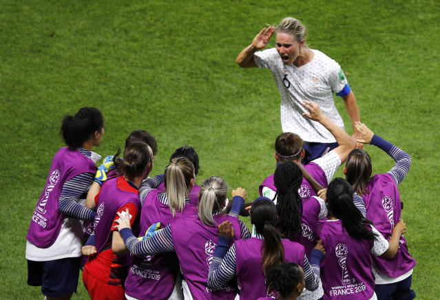 France's Amandine Henry celebrates with teammates after scoring her side's second goal during the Women's World Cup round of 16 soccer match between France and Brazil at Stade Oceane, in Le Havre, France, Sunday, June 23, 2019. (AP Photo/Francois Mori)