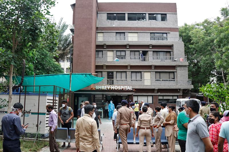 Police officers and relatives outside a hospital where a fire broke out on Thursday in Ahmedabad, India, killing eight Covid-19 patients: REUTERS
