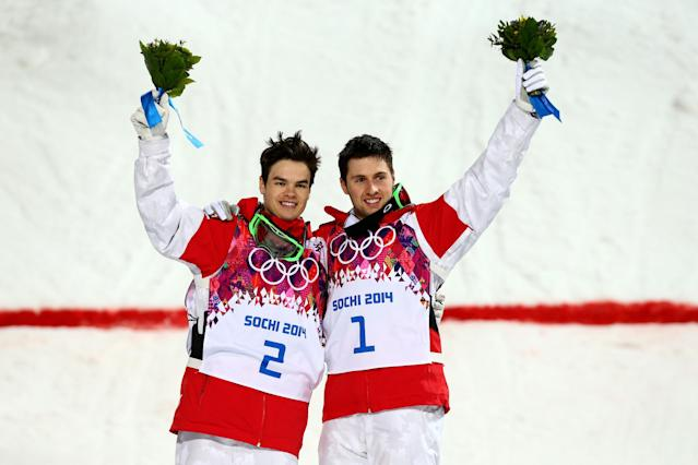 SOCHI, RUSSIA - FEBRUARY 10: (L-R) Silver medalist Mikael Kingsbury of Canada and gold medalist Alex Bilodeau of Canada celebrate on the podium during the flower ceremony for the Men's Moguls Finals on day three of the Sochi 2014 Winter Olympics at Rosa Khutor Extreme Park on February 10, 2014 in Sochi, Russia. (Photo by Cameron Spencer/Getty Images)