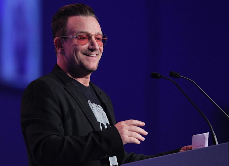 Irish singer and frontman of U2, Bono addresses delegates in Dublin, Ireland, on March 7, 2014 during The European People's Party (EPP) conference (AFP Photo/Peter Muhly)