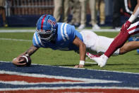 Mississippi quarterback Matt Corral (2) stretches over the goal line for a seven-yard touchdown run against Arkansas during the first half of an NCAA college football game, Saturday, Oct. 9, 2021, in Oxford, Miss. (AP Photo/Rogelio V. Solis)