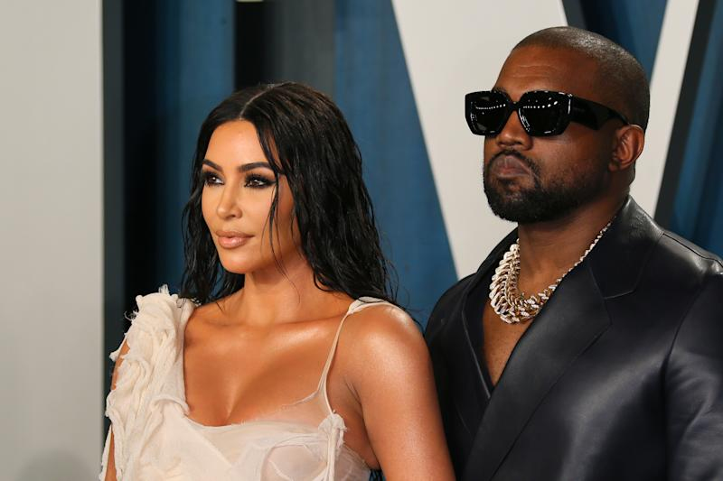 US media personality Kim Kardashian (L) and husband US rapper Kanye West attend the 2020 Vanity Fair Oscar Party following the 92nd Oscars at The Wallis Annenberg Center for the Performing Arts in Beverly Hills on February 9, 2020. (Photo by Jean-Baptiste Lacroix / AFP) (Photo by JEAN-BAPTISTE LACROIX/AFP via Getty Images)