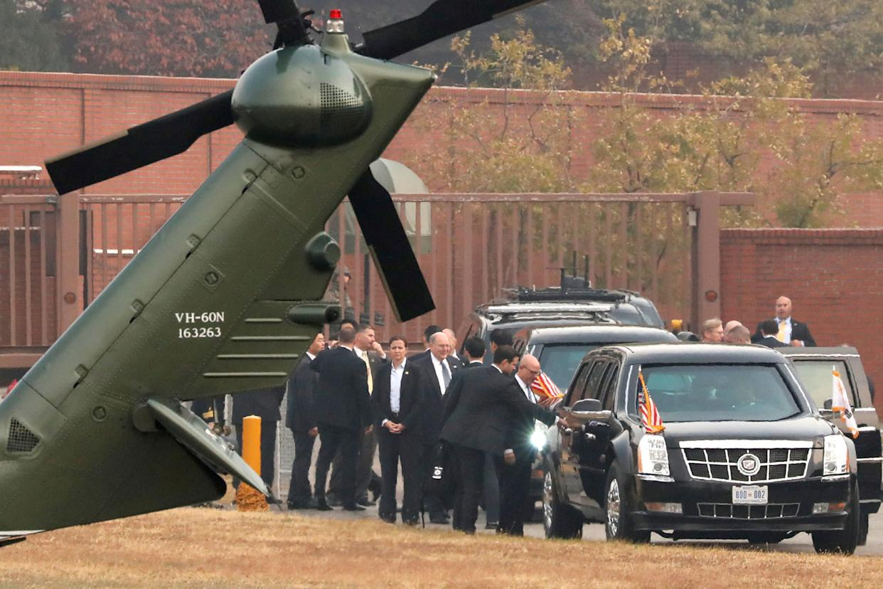 White House senior staff discuss the situation as U.S. President Donald Trump sits in his car after being grounded from an attempt to visit the Demilitarized Zone (DMZ) in the truce village of Panmunjom dividing North Korea and South Korea, at a U.S. military post in Seoul.