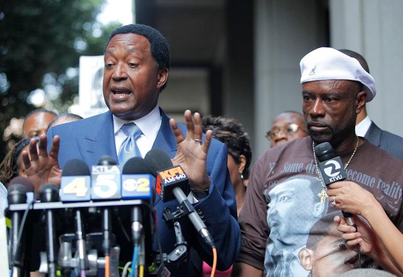 """In this 2010 photo, John Burris, left, the Oscar Grant family attorney, and Cephus """"Uncle Bobby"""" Johnson, right, express their disappointment outside a Los Angeles court after a jury found BART police officer Johannes Mehserle only guilty of involuntary manslaughter of Grant while he laid on his stomach on an Oakland train platform."""