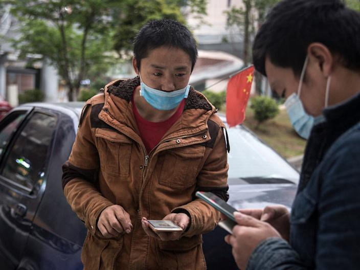 Residents make an Alipay transaction in Wuhan on April 2, 2020.