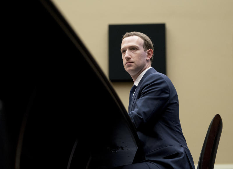 FILE - In this April 11, 2018, file photo, Facebook CEO Mark Zuckerberg listens to a question as he testifies before a House Energy and Commerce hearing on Capitol Hill in Washington, about the use of Facebook data to target American voters in the 2016 election and data privacy. A U.S. congressional committee has requested a trove of internal Facebook documents that the company's critics say will demonstrate how the social media giant unfairly leveraged its market dominance to crush or absorb competitors. (AP Photo/Andrew Harnik, File)