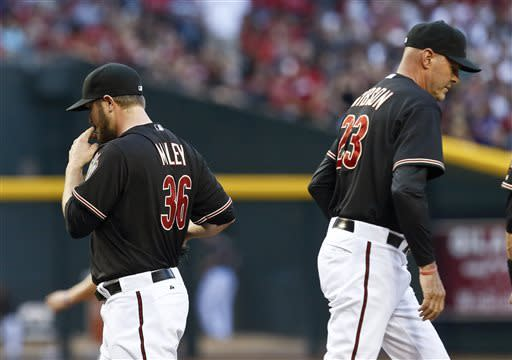 Arizona Diamondbacks manager Kirk Gibson (23) takes pitcher Wade Miley (36) out of the game in the fifth inning during a baseball game against the Colorado Rockies, on Saturday, April 27, 2013, in Phoenix. AP Photo/Ross D. Franklin)