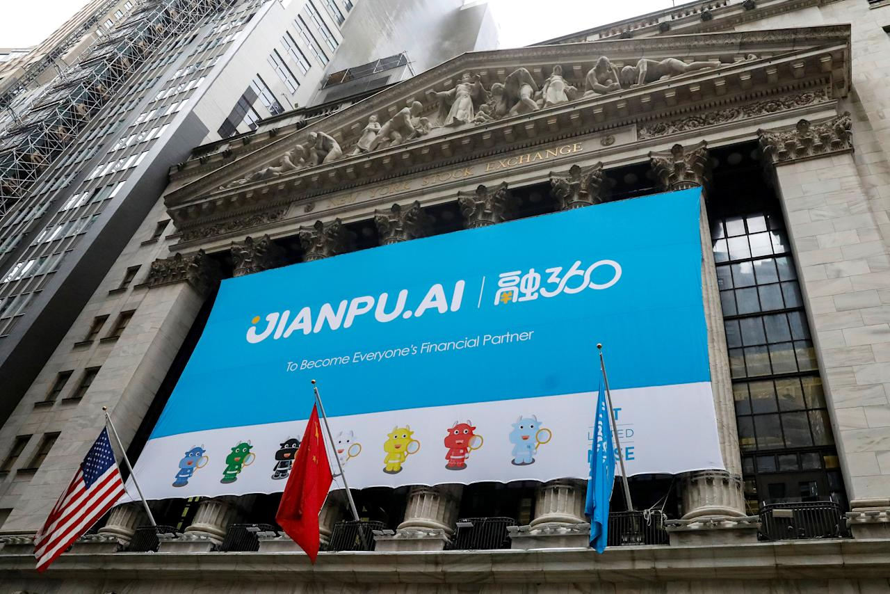 FILE PHOTO: A banner for Jianpu Technology Inc. hangs on the front of the New York Stock Exchange (NYSE) to celebrate the company's IPO in New York, U.S., November 16, 2017. REUTERS/Brendan McDermid/File Photo