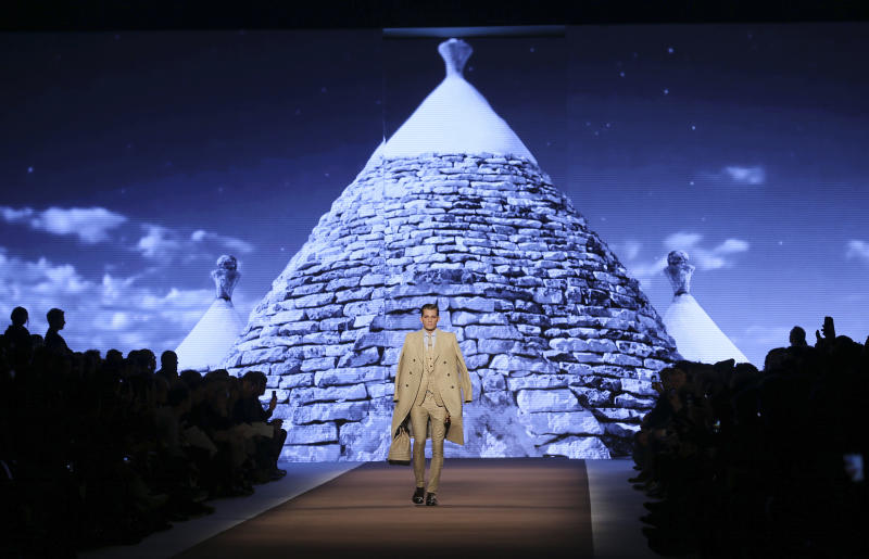 A model wears a creation for Etro men's Fall-Winter 2014 collection, part of the Milan Fashion Week, unveiled in Milan, Italy, Monday, Jan. 13, 2014. (AP Photo/Antonio Calanni)
