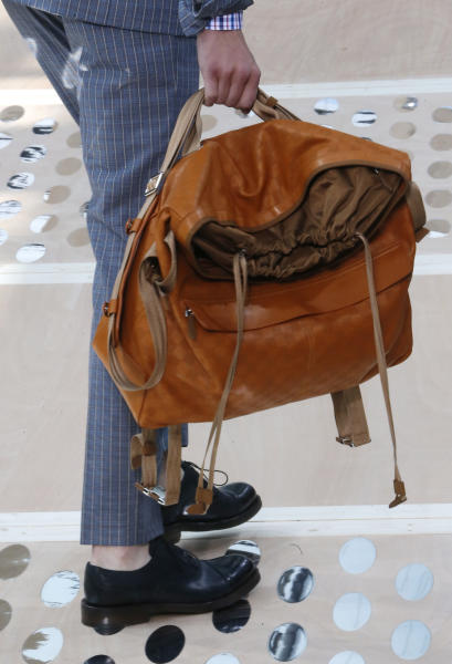 A model holds a bag by British fashion designer Kim Jones for Louis Vuitton's Spring-Summer 2014 men's collection presented Thursday, June 27, 2013 in Paris. (AP Photo/Jacques Brinon)