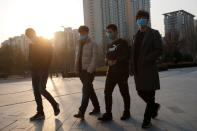 People wears a face mask an office complex in Beijing as the country is hit by an outbreak of the novel coronavirus