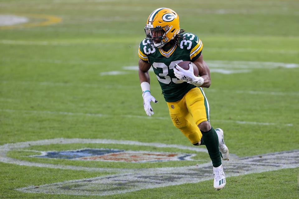 GREEN BAY, WISCONSIN - JANUARY 24: Aaron Jones #33 of the Green Bay Packers runs with the ball in the second quarter against the Tampa Bay Buccaneers during the NFC Championship game at Lambeau Field on January 24, 2021 in Green Bay, Wisconsin. (Photo by Dylan Buell/Getty Images)