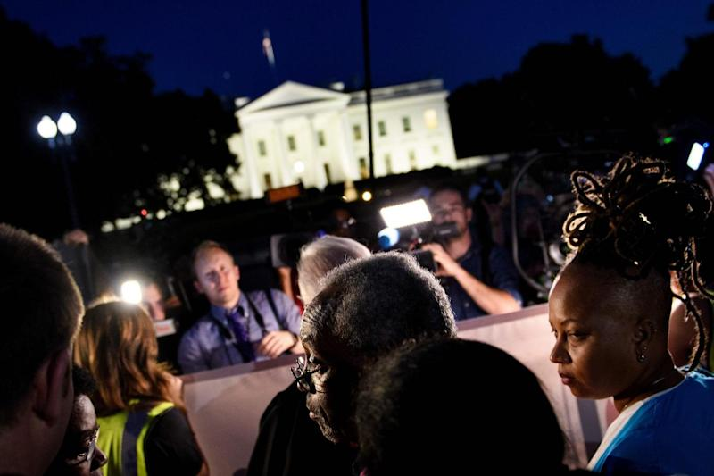 Rev Curry stands opposite the White House (AFP/Getty Images)