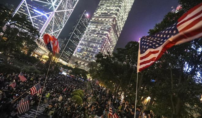 Protesters wave American flags on October 14 during a protest to urge US congressmen to pass the Hong Kong Human Rights and Democracy Act. Photo: Felix Wong